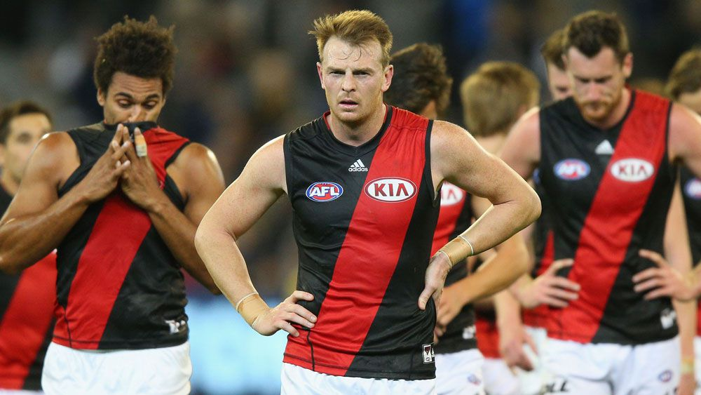 Brendon Goddard (centre) with Bombers teammates. (Getty)