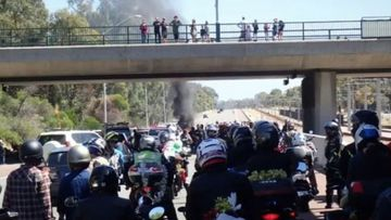 The 39-year-old woman has died during a Christmas charity ride on a freeway in Western Australia.