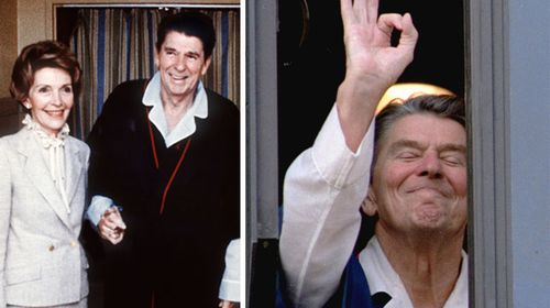 Ronald Reagan with wife Nancy and signalling from his hospital window after the shooting. (AAP)