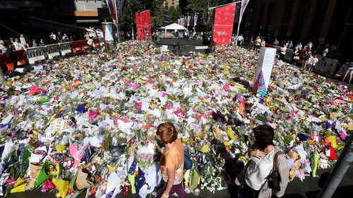 Martin Place was flooded in a sea of colour as people shared in their grief for the victims and hostages of the Lindt cafe siege. (AAP)