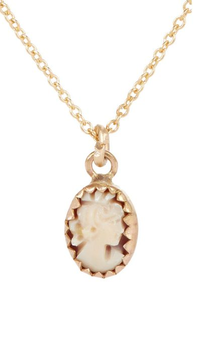 "<a href=""http://www.barneys.com/julie-wolfe-gold-%26-shell-cameo-pendant-necklace-503251439.html?utm_medium=affiliate&siteID=Hy3bqNL2jtQ-U0SoyDt3iWq862EvuYJ_OQ&utm_source=Hy3bqNL2jtQ "">Gold & Shell Cameo Pendant Necklace, approx. $674, Julie Wolfe</a>"