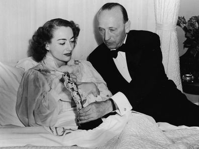 Joan Crawford accepts her Oscar in bed.