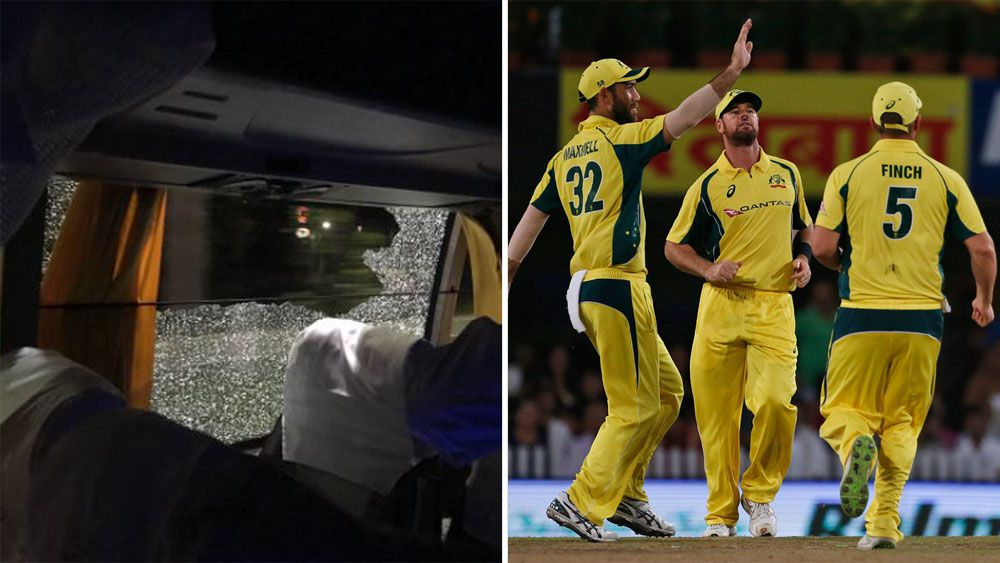 Two arrested over Aussie cricket rock toss