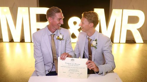 Craig Burns (left) and Luke Sullivan tied the knot just after the stroke of midnight. (9NEWS)