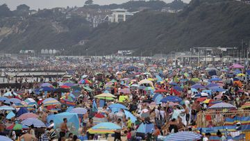This beach in Bournemouth is packed with people during a particularly hot summer.