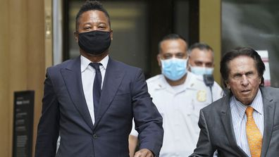 Cuba Gooding Jr., left, and his attorney Mark J. Heller, right, leave court after a hearing in Gooding's sexual misconduct case, Thursday, Aug. 13, 2020, in New York