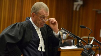 """August 7, 2014: State prosecutor Gerrie Nel, in his final argument before the court, accuses Pistorius of concocting an alibi that led to a """"snowball effect"""" of lies. (Getty)"""