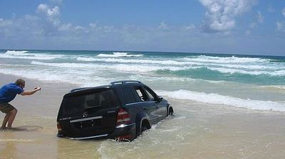 "<p _tmplitem=""1"">An idyllic off road drive on the sands of Fraser Island has cost the owner of a Mercedes Benz 4WD their car.</p><p _tmplitem=""1""> Pictures taken over the weekend and uploaded to social media show the $40,000 car submerged in the sand and being battered by waves. </p><p _tmplitem=""1""> Click through this gallery to see more pictures of the sorry wreck. </p><p _tmplitem=""1""> </p>"