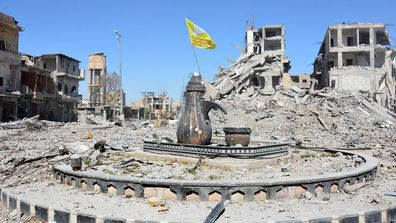 The city of Raqqa, which was controlled by ISIS for three years, with the main square where they'd do beheading.