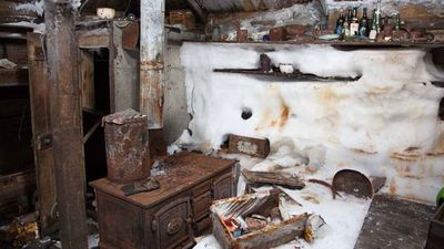 View of the kitchen area in Mawson's Hut. The door to Frank Hurley's darkroom can be seen on the left.