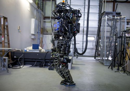 The capabilities of the Boston Dynamics funded Atlas robot are demonstrated during the Massachusetts Institute of Technology's Computer Science and Artificial Intelligence Laboratory's Demo Day in 2013.