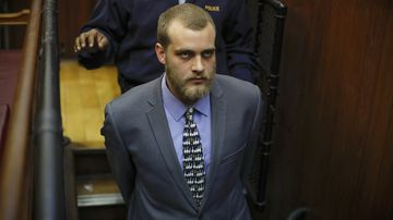 Henri van Breda is led from the dock after the sentences were handed down. (AAP)