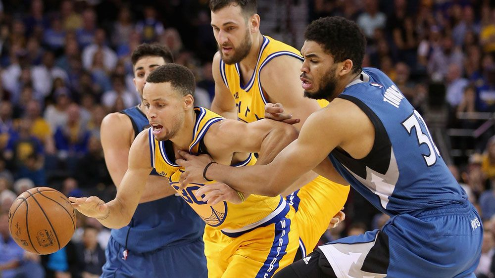 Steph Curry is mauled in the Warriors' shock loss to Minnesota. (Getty)