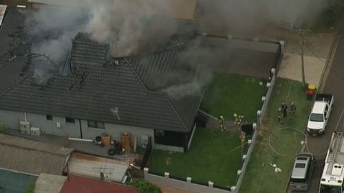 Several people have been treated for smoke inhalation after the blaze gutted the Villawood house. (9NEWS)