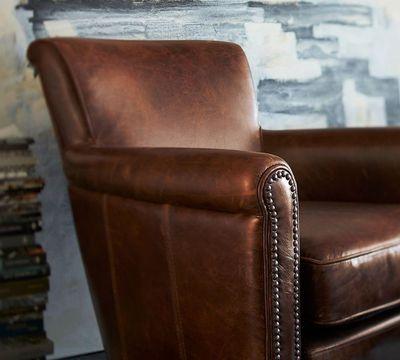 "<a href=""http://www.potterybarn.com.au/irving-professor-leather-armchair-nailhead"" target=""_blank"">Pottery Barn Irving Leather Armchair, $1669.</a>"