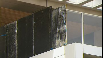 Panes of glass falling from Perth apartment just miss pedestrians