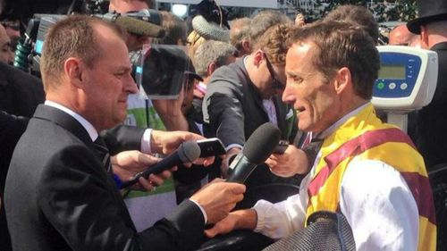 Damien Oliver talks to reporters after his winning Victoria Derby ride. (Twitter/Spring Carnival)