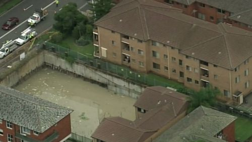 The sinkholes spread from a flooded building site nearby. (9NEWS)