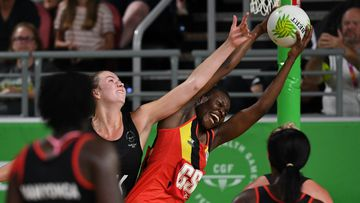 Kelly Jury of New Zealand and Peace Proscovia of Uganda fight for possession of the ball. (AAP)