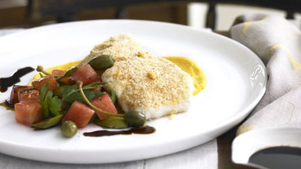 Olive oil-poached groper with romesco crumbs, pumpkin purée and caperberry and olive salad