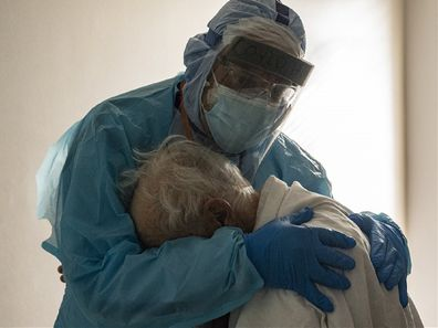 Doctor embraces patient in hospital during the coronavirus pandemic in the United States.