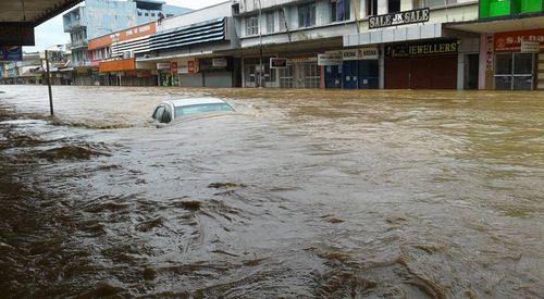 Photos posted on social media from locals shows cars and shops under metres of water. (Facebook)