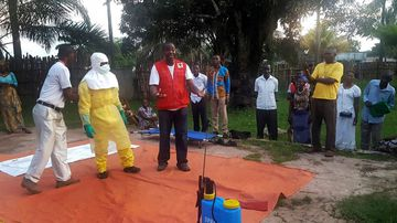 Members of a Red Cross team don protective clothing before heading out to look for suspected victims of Ebola, in Mbandaka. Picture: AP
