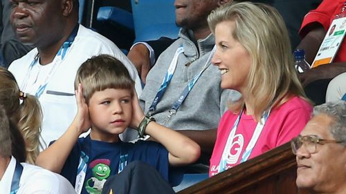 Sophie, Countess of Wessex and her son James, Viscount Severn, who may be finding the noise a bit much as Scotland play New Zealand in the Rugby Sevens.