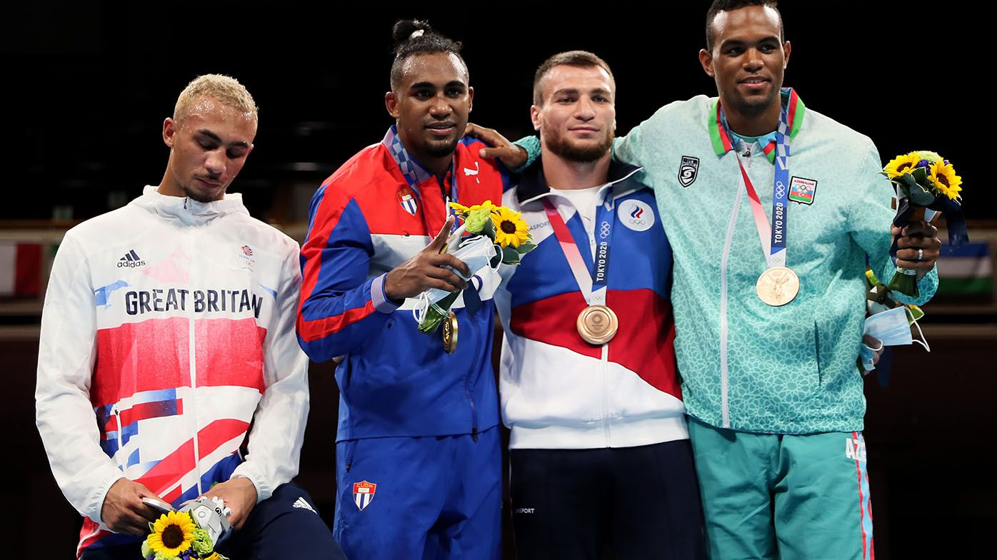 Fuming boxer refuses to wear silver medal