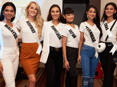 Htet (second from right) pictured with fellow Mis Universe contestants.