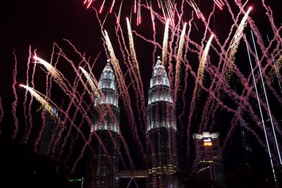 "People are celebrating the start of the new year in front of the ""Petronas Twin Towers"" in Kuala Lumpur, Malaysia."
