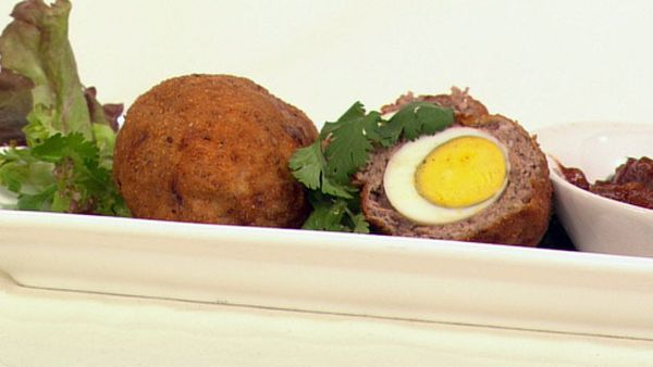 Baharat scotch eggs with spicy tomato sauce