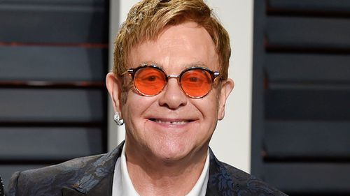 Elton John arrives at the Vanity Fair Oscar Party in Beverly Hills, California on February 27. (AAP)