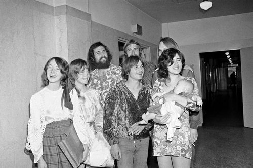 "Members of Charles Manson's ""family"" congregate in Los Angeles Hall of Justice, Feb. 24, 1970, for arraignment of Patricia Krenwinkel."