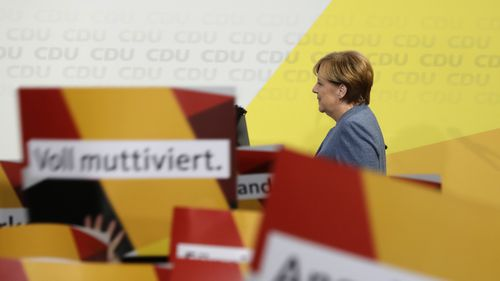 Chancellor Angela Merkel vows to win back voters from nationalist Alternative for Germany. (AAP)