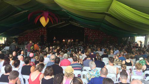Festival-goers listen to Hawke's speech at the Woodford Folk Festival. (9NEWS/Joel Dry)