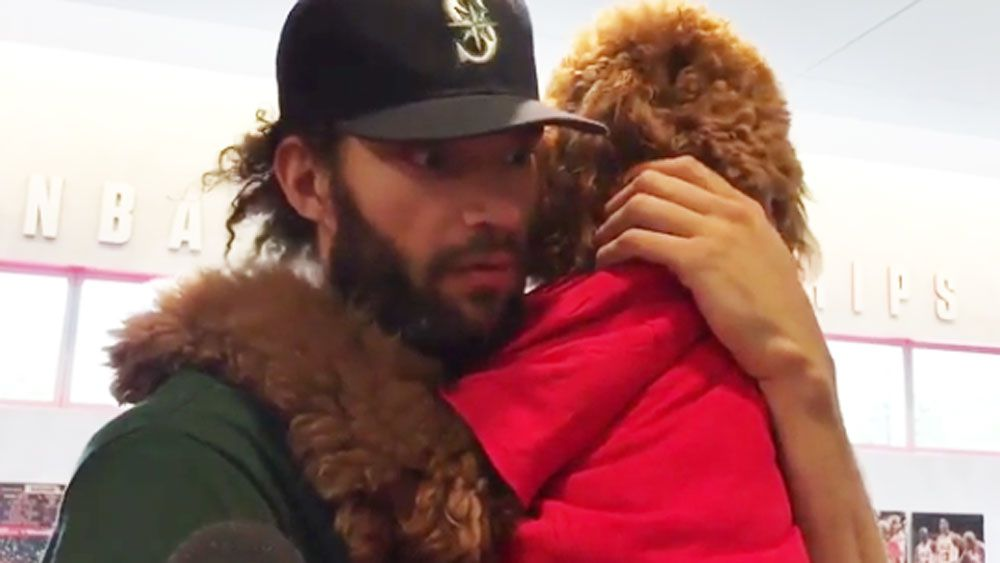 Chicago Bulls centre Robin Lopez addresses future while holding his dog at press conference