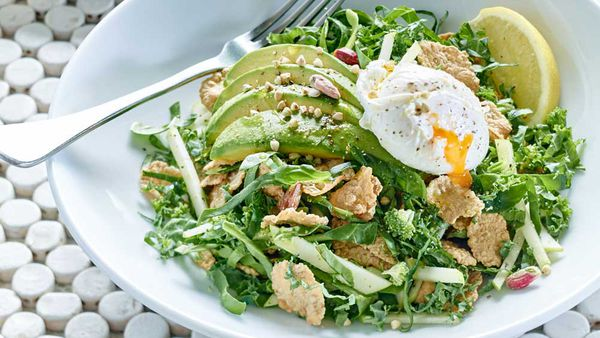 Gluten free breakfast salad with poached egg and avocado