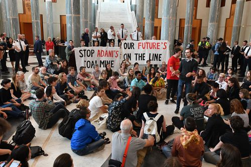 Students set up a peaceful protest on the marble floors of parliament to address the climate change issue with the prime minister.