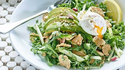 Gluten free breakfast salad with poached egg, kale and avocado