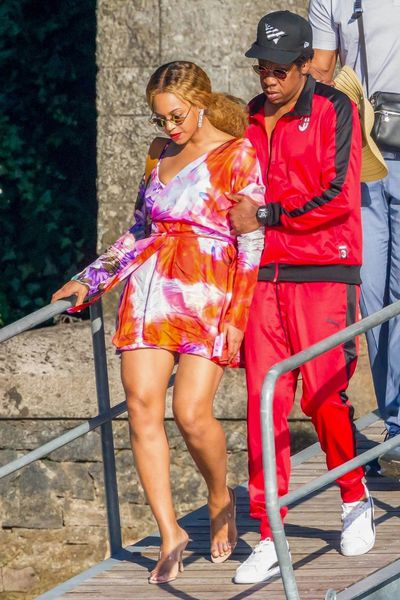 "Jay- Z and Beyonc&eacute; are unrivalled when it comes to making a <a href=""https://style.nine.com.au/2017/07/20/15/34/couple-dressing-blake-lively-ryan-reynolds"" target=""_blank"" title=""joint sartorial statement."">joint sartorial statement.</a><br /> <a href=""https://style.nine.com.au/2018/07/09/14/01/kourntey-kardashian-sideboob"" target=""_blank""><br /> Currently in Italy</a> in the middle of their On the Run II tour, the Carters took some time off over the weekend to turn the serene streets of Lake Como into a catwalk.<br /> <br /> Even off-duty, the Single Ladies singer refuses to turn it down a notch, stepping out in a silk floral wrap dress from MSGM and Manolo Blahnik PVC mules. A pair of diamond earrings and gold sunglasses gave the outfit a polished finish.<br /> <br /> Jay Z also put his sartorial foot forward in a red and black velour tracksuit from Puma.<br /> <br /> The two-day mini break may be the last time the power pair take some time off for quite some time. They have just been announced as the headline act for the Global Citizen Festival in South Africa, a celebration to be held in December to honour the 100th anniversary birth of Nelson Mandela.<br /> <br /> Joining Jay and Bey onstage will be Chris Martin, Usher, Pharrell Williams, Ed Sheeran and Eddie Vedder. <br /> <br /> It may be a while before they turn it up in the style stakes in Johannesburg, so in the meantime we have selected of 10 of our favourite style moments from Jay Z and Beyonc&eacute; from over the years.<br /> <br /> From their days of wearing double denim in the early &lsquo;000s to the high-voltage designer looks they are regularly&nbsp;"