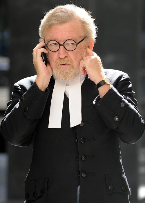 Robert Richter, QC, speaks on the phone outside the Supreme Court in Brisbane in 2009.
