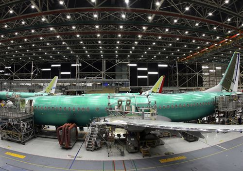 A Boeing 737 MAX 8 airplane is shown on the assembly line during a brief media tour in Boeing's 737 assembly facility, in Renton, Washington. Aviation authorities around the world grounded the plane in March after two fatal crashes.