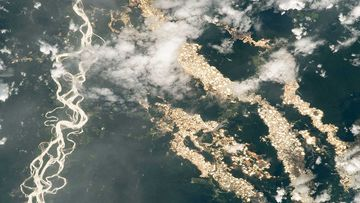 This photo taken from the International Space Station appears to show rivers of gold. But the reality is much grimmer.