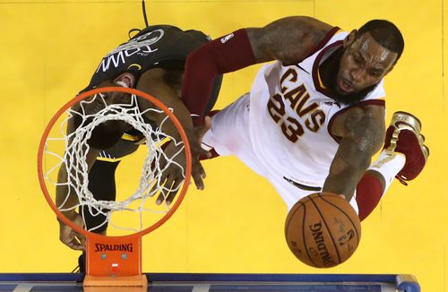 Golden State Warriors player Draymond Green (L) tries to block a shot against Cleveland Cavaliers player LeBron James (R) in the second half of game two of the NBA Finals at Oracle Arena in Oakland, California, on Sunday. Picture: AAP