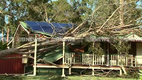 Power still out more than 18 hours after south-east Queensland storms, with more wild weather forecast