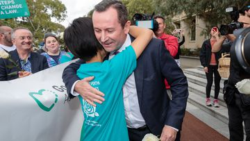 Voluntary assisted dying campaigner Belinda Teh is greeted by WA Premier Mark McGowan outside Parliament House in Perth.