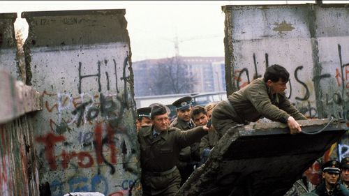 The Berlin Wall opening in Berlin, Germany on November, 1989. (Photo by Patrick PIEL/Gamma-Rapho via Getty Images)