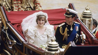 Diana, Princess of Wales and Prince Charles ride in a carriage after their wedding at St. Paul's Cathedral.