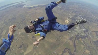 "<p>A skydiver who suffered a seizure and blacked out in mid-air was saved by his jumping instructor as he plummeted unconscious towards the earth.</p> <p> The man, who gave his name as only Christopher, was doing stage five of the Accelerated Free Fall program in November last year when he had a fit seconds after jumping out of the plane. </p> <p> ""At around 2700 metres I have a seizure while attempting a left hand turn,"" the man wrote in the video, which was uploaded to YouTube on Sunday. </p> <p> ""I then spend the next 30 seconds in free fall unconscious. </p> <p> ""Thankfully my jumpmaster manages to pull my ripcord at around 1200 metres. I become conscious at 900 metres and landed safely back to the ground."" </p> <p> Not surprisingly, the man said the nightmarish experience was ""possibly the scariest moment of his life"".</p> <p> The video has received over 200,000 views in less than a day. </p> <p> Click through this gallery for more mile high skydiving drama. </p> <p> </p>"
